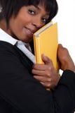 Businesswoman hugging a folder Royalty Free Stock Photo