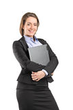 Businesswoman hugging a laptop Royalty Free Stock Photo