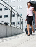 Businesswoman in a hurry Royalty Free Stock Photos