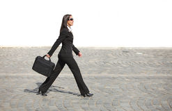 Businesswoman in a hurry Stock Images