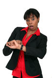 Businesswoman in a hurry. Looking at her watch Royalty Free Stock Image