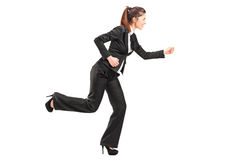 Businesswoman in hurry running Royalty Free Stock Photo