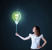 Businesswoman with an idea bulb Stock Image