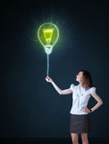 Businesswoman with an idea bulb Stock Photo