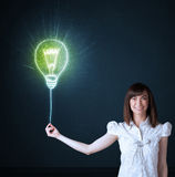 Businesswoman with an idea bulb Royalty Free Stock Photos