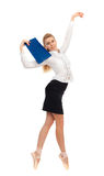 Businesswoman in the image of a dancer. With a folder in his hand on a white background royalty free stock image