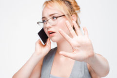 Businesswoman important phone call, don`t disturb. Businesswoman in glasses busy with important mobile phone call. Wait, don`t interrupt or disturb Royalty Free Stock Photography