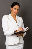 Businesswoman In A White Suit With A Notebook Royalty Free Stock Image