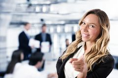 Businesswoman that indicates on the camera. Concept of people recruitment royalty free stock photography