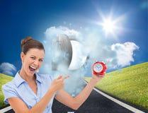 Businesswoman indicating alarm clock Stock Images