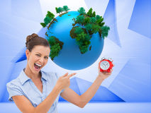 Businesswoman indicating alarm clock Royalty Free Stock Image