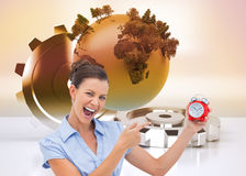 Businesswoman indicating alarm clock Stock Photos
