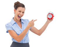 Businesswoman indicating alarm clock Royalty Free Stock Photo