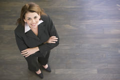 businesswoman indoors smiling standing στοκ εικόνες