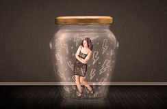 Businesswoman inside a glass jar with lightning drawings concept Royalty Free Stock Images
