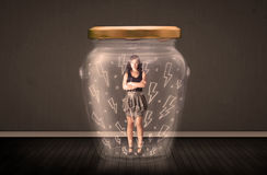 Businesswoman inside a glass jar with lightning drawings concept Stock Photography