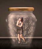 Businesswoman inside a glass jar with lightning drawings concept. On background stock photo