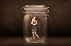 Businesswoman inside a jar with powerful hand drawn lines concep Royalty Free Stock Photo