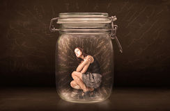 Businesswoman inside a jar with powerful hand drawn lines concep Royalty Free Stock Images