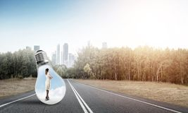 Businesswoman inside light bulb royalty free stock photos