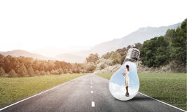 Businesswoman inside light bulb Royalty Free Stock Photography