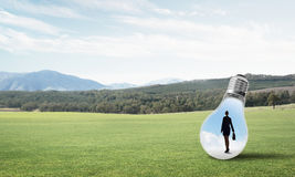 Businesswoman inside light bulb Stock Photography