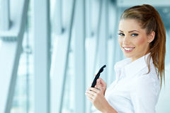 Businesswoman inside a modern house Stock Images