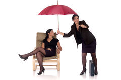 Businesswoman insurance agent. Attractive businesswoman,  insurance agent with umbrella.  Studio, white background Royalty Free Stock Photography