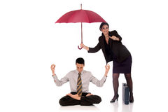 Businesswoman insurance agent. Attractive businesswoman,  insurance agent with umbrella, man meditating.  Studio, white background Stock Image