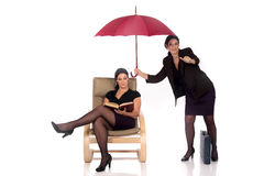 Businesswoman insurance agent. Attractive businesswoman,  insurance agent with umbrella.  Studio, white background Stock Photography