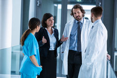 Businesswoman interacting with doctors Stock Images