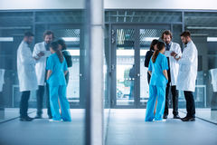 Businesswoman interacting with doctors Stock Photo