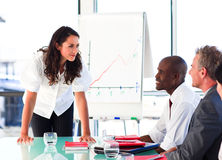 Businesswoman interacting with her colleagues Royalty Free Stock Photos