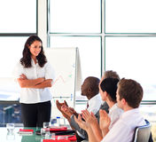 Businesswoman interacting with her team in a pres Royalty Free Stock Images