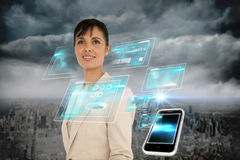 Businesswoman with interface and smartphone Stock Photos