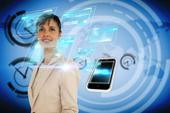 Businesswoman with interface and smartphone Royalty Free Stock Images
