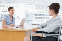 Businesswoman interviewing disabled candidate Royalty Free Stock Photos