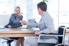 Businesswoman interviewing disabled job candidate Stock Image