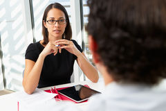 Businesswoman Interviewing Male Candidate Stock Photo