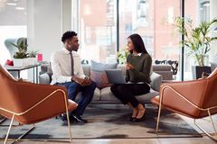 Free Businesswoman Interviewing Male Job Candidate In Seating Area Of Modern Office Royalty Free Stock Photography - 157267957