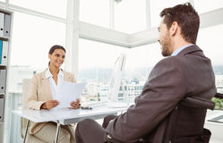 Businesswoman interviewing man in office Royalty Free Stock Photos
