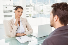 Businesswoman interviewing man in office Royalty Free Stock Photo