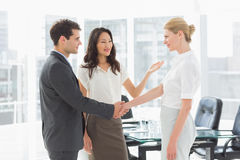 Businesswoman introducing colleagues Stock Image