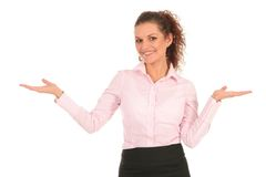 Businesswoman introducing something Stock Images