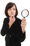 Businesswoman investigates using a magnifier. Isolated on a white background royalty free stock images