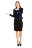 Businesswoman inviting to an office. Blonde businesswoman inviting to an office Royalty Free Stock Images