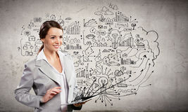Businesswoman with ipad. Attractive businesswoman holding ipad. Business project sketch Stock Photos