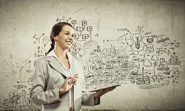 Businesswoman with ipad. Image of young businesswoman holding ipad against sketch background Stock Images