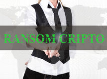 Businesswoman in a jacket and tie pressing ransom cripto button of a virtual screen. exchange and production of crypto Stock Photo