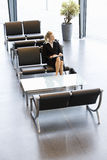 A businesswoman or job candidate sitting in a waiting room Royalty Free Stock Images